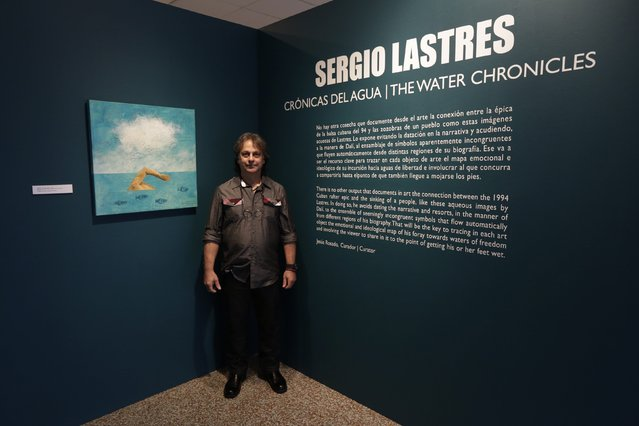 Former Cuban rafter Sergio Lastres, 49, poses at an exhibition of his work based on the 1994 Cuban raft exodus in Miami, September 19, 2014. Lastres and his wife were among 15 migrants rescued when their raft filled with water in 1994. They were taken to Guantanamo Base where he painted his first work about rafters, he said. (Photo by Rolando Pujol Rodriguez/Reuters)