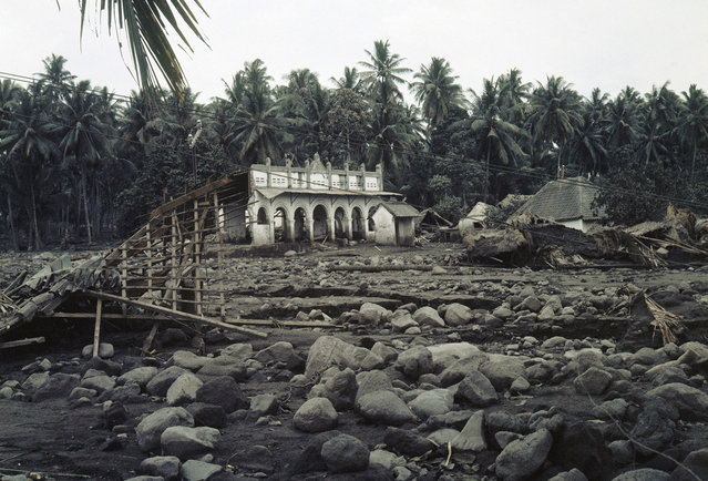 After the eruption of Mount Agung in Bali, on March 26, 1963, most of the cabins have been destroyed in this village. On March 17, the volcano erupted, sending debris into the air and generating massive pyroclastic flows. These flows devastated numerous villages, killing approximately 1,500 people. (Photo by AP Photo)