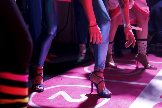 Contestants prepare to start in a high heels race in Paris, France, October 15, 2015. (Photo by Charles Platiau/Reuters)