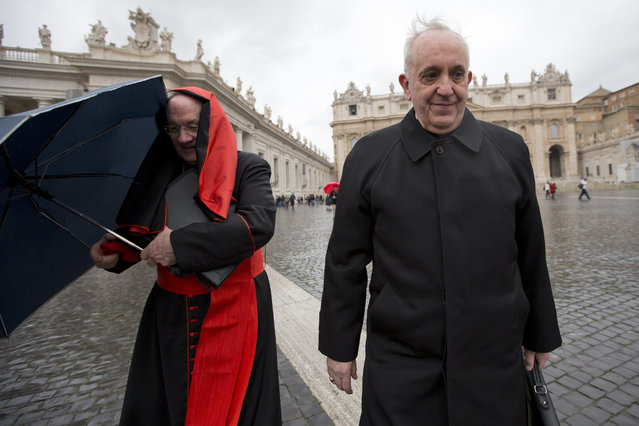 Canadian Cardinal Marc Ouellet, left, holds on to his umbrella next to Argentine Cardinal Jorge Mario Bergoglio as they walk in St. Peter's Square after attending a cardinals' meeting, at the Vatican, Wednesday, March 6, 2013. Cardinals are meeting to discuss the problems of the church and to get to know one another because there is no clear front-runner in the election of the new pope. (Photo by Andrew Medichini/AP Photo)