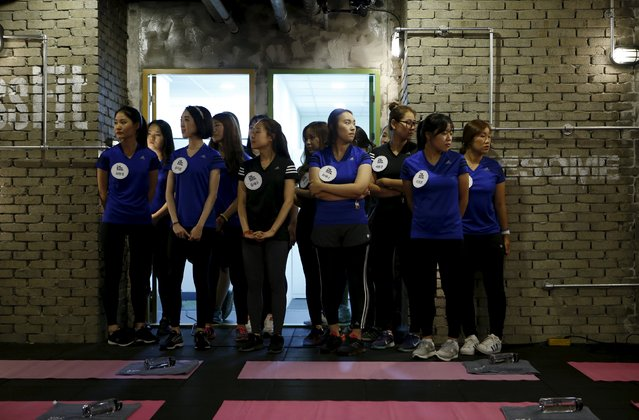 "Participants gather before the start of a workout session during TV program ""The Body Show"" at a gym in Seoul, September 19, 2015. (Photo by Kim Hong-Ji/Reuters)"