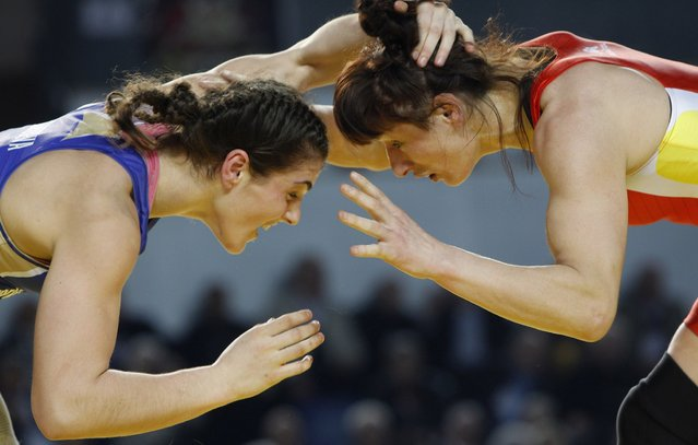 Spain's Maider Gonzalez De Audicana (red) wrestles with Russia's Natalia Vorobieva during the female wrestling 72kg gold medal match at the Senior Wrestling European Championship in Tbilisi, March 22, 2013. (Photo by David Mdzinarishvili/Reuters)