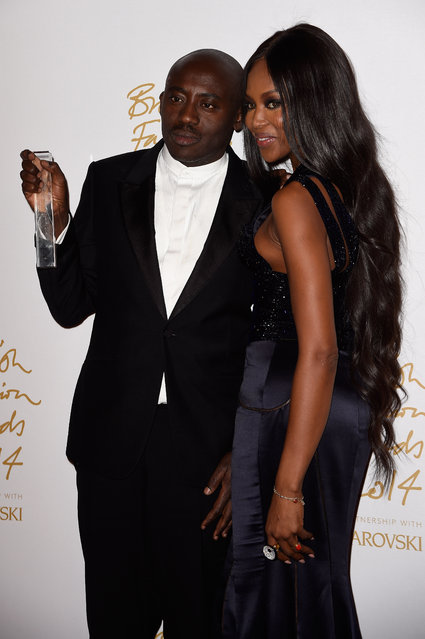 Isabella Blow Award for Fashion Creator winner Edward Enninful and Naomi Campbell pose in the winners room at the British Fashion Awards at London Coliseum on December 1, 2014 in London, England. (Photo by Pascal Le Segretain/Getty Images)