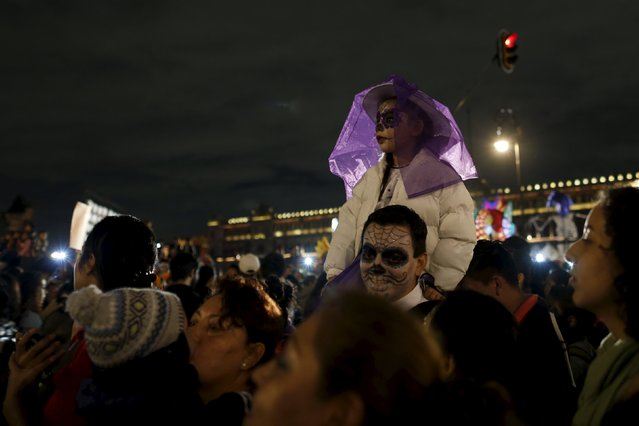 "A child dressed up as a ""Catrina"", a Mexican character also known as ""The Elegant Death"", is pictured during a Catrinas parade in Mexico City October 31, 2015. (Photo by Carlos Jasso/Reuters)"