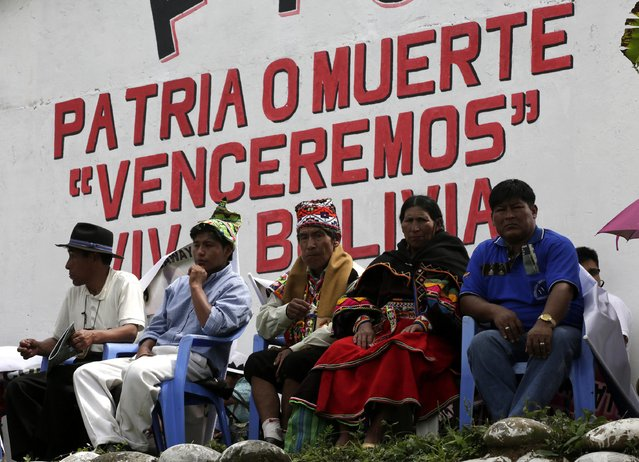 Indigenous leaders attend the end of the ceremony for the task of fighting against drugs in Chimore, east of La Paz, December 10, 2014. (Photo by David Mercado/Reuters)