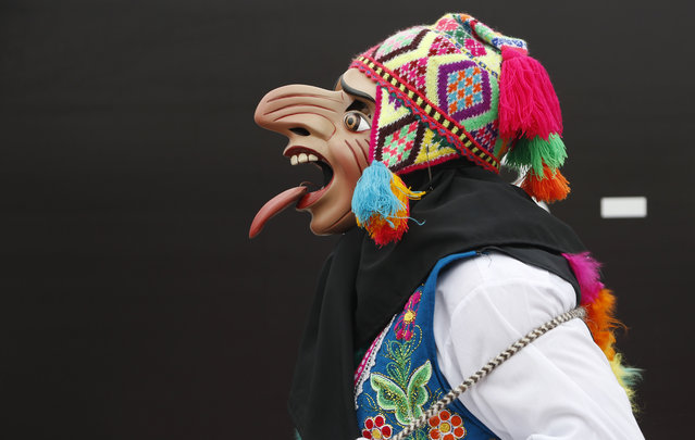 A dancer walks before a performance at the Climate Change Conference in Lima, Peru, Tuesday, December 9, 2014. Delegates from more than 190 countries are meeting in Lima, to work on drafts for a global climate deal that is supposed to be adopted next year in Paris. (Photo by Juan Karita/AP Photo)