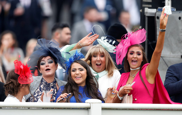 Racegoers during the 14:20 Betway Top Novices' Hurdle during Ladies Day at the Grand National Festival at Aintree Racecourse on April 13, 2018 in Liverpool, England. (Photo by Matthew Childs/Reuters/Action Images)