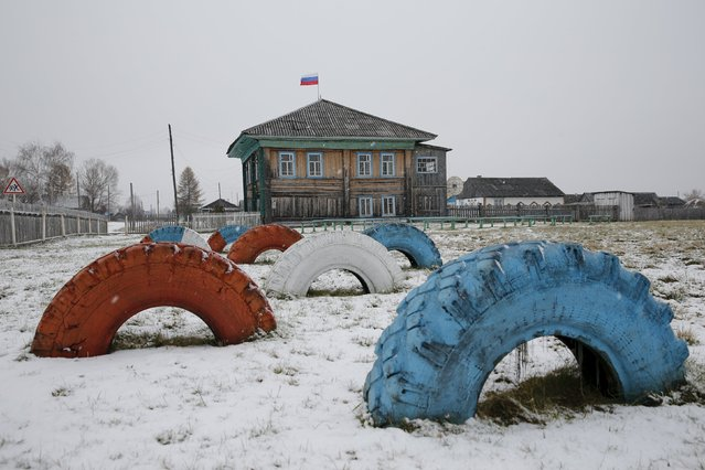 Car tyres painted in the colours of the Russian flag stand in front of the administration building in Sankin, Sverdlovsk region, Russia October 17, 2015. (Photo by Maxim Zmeyev/Reuters)