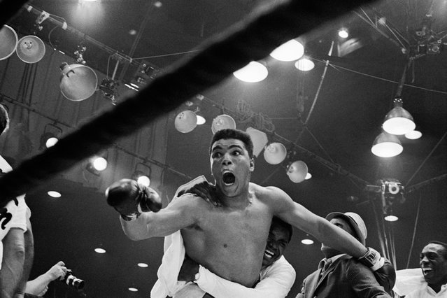 """I'm the champ!"" screams Cassius Clay as his handlers hug him joyfully after he defeated Sonny Liston for the heavyweight boxing title. Clay was credited with a 7th round TKO when Liston was unable to answer the bell because of a shoulder injury suffered in the first round. February 25,  1964, Miami Beach, Florida, USA. (Photo by Bettmann/Corbis)"