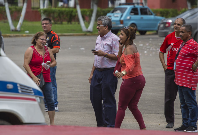 Relatives of passengers a Boeing 737 that plummeted into a yuca field with more than 100 passengers on board, arrive near the airport terminal in Havana, Cuba, Friday, May 18, 2018. The Cuban airliner crashed just after takeoff from Havana's international airport. (Photo by Desmond Boylan/AP Photo)