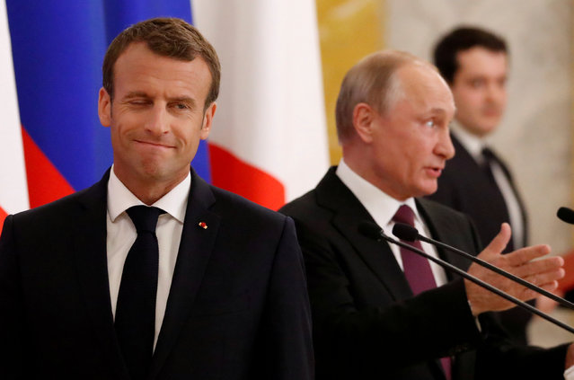 Russian President Vladimir Putin (R) and his French counterpart Emmanuel Macron attend a news briefing after the talks in St. Petersburg, Russia May 24, 2018. (Photo by Grigory Dukor/Reuters)