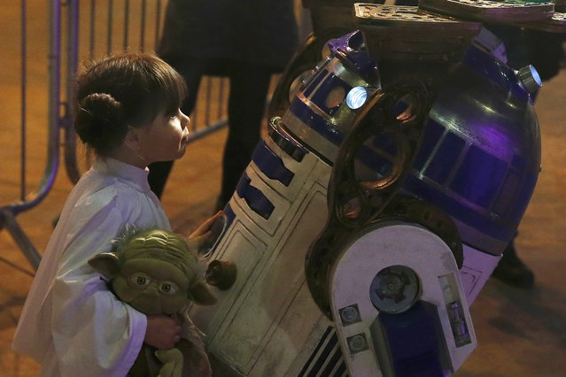 Audrey Mata from Washington D.C in the U.S. dressed as Princess Leia, comes face to face with a replica of R2-D2 at the  'For The Love of The Force' Star Wars fan convention in Manchester, northern England, December 4, 2015. (Photo by Phil Noble/Reuters)