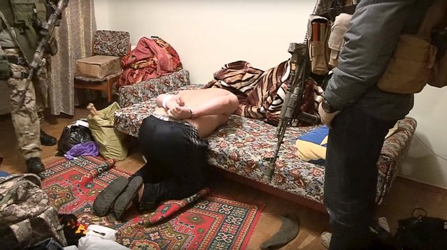 A frame from undated footage released to Reuters TV shows a handcuffed man detained in Kiev as shown by Ukrainian security service in Kiev, Ukraine, December 10, 2015. Ukraine's security service said on Thursday it had broken up an armed insurgent group that operated out of Kiev and other major Ukrainian cities and that two people had been killed during the operation. (Photo by Reuters/Ukrainian Security Service)