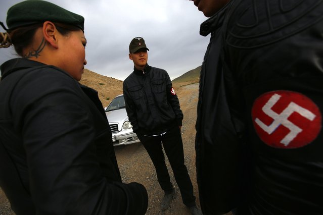 Members of the Mongolian neo-Nazi group Tsagaan Khass stand near a quarry, where they questioned a worker, southwest of Ulan Bator June 23, 2013. (Photo by Carlos Barria/Reuters)
