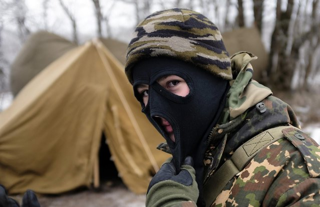 A student from the General Yermolov Cadet School wearing a mask looks on during a field exercise outside the south Russian city of Stavropol January 25, 2015. (Photo by Eduard Korniyenko/Reuters)