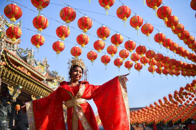 A woman attends celebrations for the Lunar New Year at a Chinese temple in Samut Prakan province, Thailand, February 12, 2021. (Photo by Chalinee Thirasupa/Reuters)