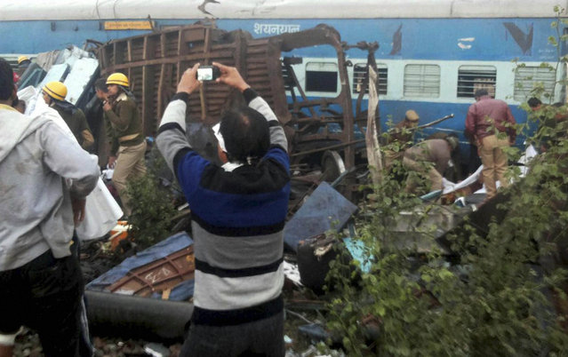 Rescue officials on the spot where 14 coaches of the Indore-Patna express derailed, killing around 90 people and injuring 150, in Kanpur Dehat on Sunday, 20 November 2016. (Photo by Press Trust of India)