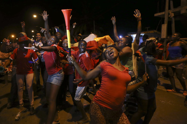 Equatorial Guinea soccer fans celebrate on a street in Malabo, Equatorial Guinea after their national soccer team beat Tunisia at their African Cup of Nations quarterfinal soccer match, Saturday, January 31, 2015. (Photo by Sunday Alamba/AP Photo)
