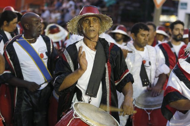 Members of a comparsa, a Uruguayan carnival group, play the drums and dance during the Llamadas parade in Montevideo February 5, 2015. (Photo by Andres Stapff/Reuters)