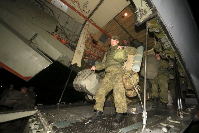 Russian marines, who guarded Russia's Hmeymim air base in Syria, disembark from a plane as they arrive at the Belbek military airport near the Black Sea port of Sevastopol, Crimea, December 28, 2015. (Photo by Pavel Rebrov/Reuters)