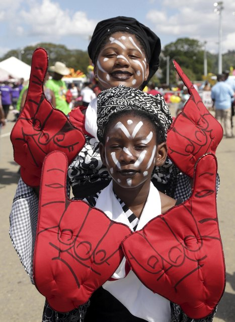 Revellers from the band Big pose for a photo before going on stage at the annual Trinidad and Tobago Red Cross Society's Children's Carnival Competition at the Queen's Park Savannah in Port-Of-Spain February 7, 2015. (Photo by Andrea De Silva/Reuters)