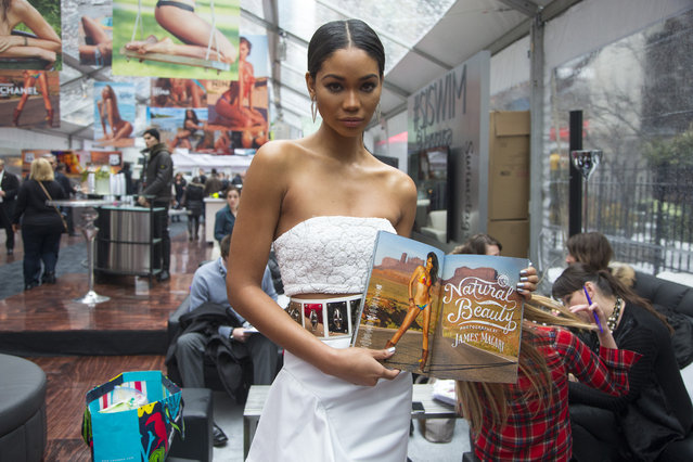 Sports Illustrated swimsuit model Chanel Iman holds the 2015 Sports Illustrated swimsuit issue during the SwimCity festival in New York City on Monday February 9, 2015. (Photo by Gordon Donovan/Yahoo News)