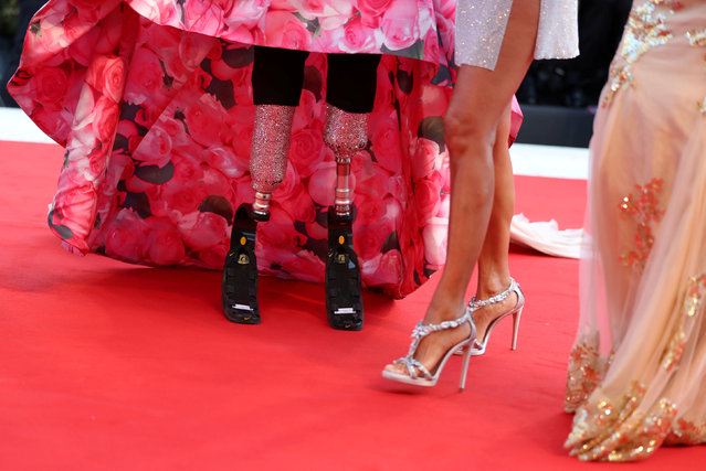 """Paralympic athlete Giusy Versace and Jo Squillo attending the """"First Man"""" premiere at the 75 th Venice International Film Festival at the Palazzo del Cinema on August 29, 2018 in Venice, Italy. (Photo by Tony Gentile/Reuters)"""