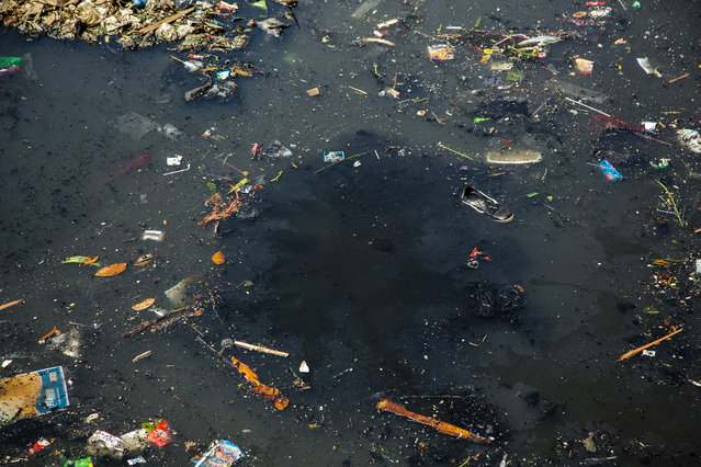 A thick black toxic stew bubbles up from the depths of the Citarum river on August 28, 2018 outside Bandung, Java, Indonesia. (Photo by Ed Wray/Getty Images)