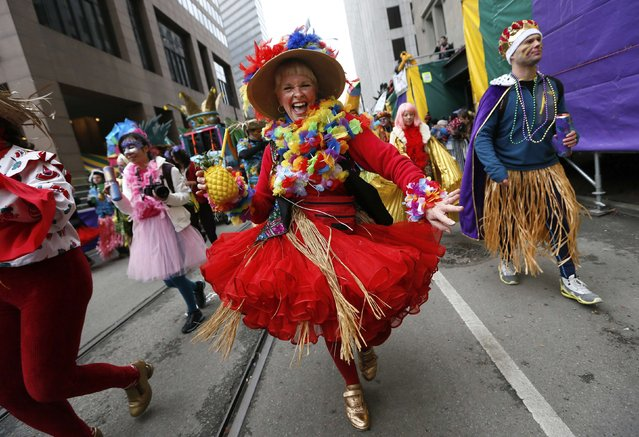 A Member of the Mondo Kayo Social and Marching Club parades down St. Charles Avenue on Mardi Gras in New Orleans, Louisiana February 17, 2015. (Photo by Jonathan Bachman/Reuters)