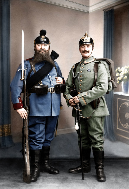 Bavarian grandfather and Prussian grandson displaying the old and new uniforms of the German army, 1st of February, 1913.