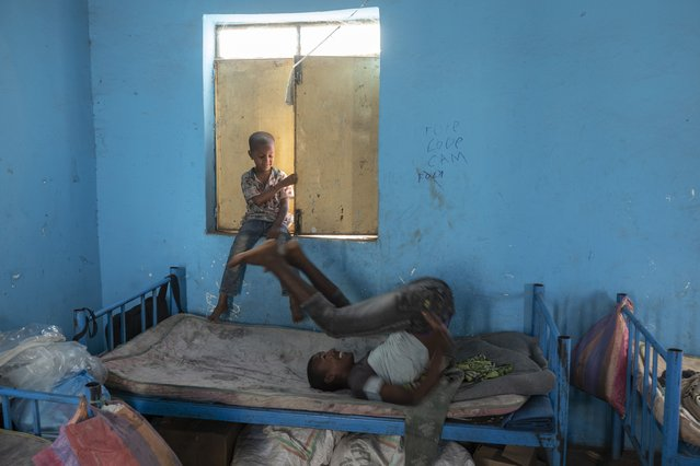 Tigrayan 5-year-old refugee Micheale Gebremariam, left, plays with a friend inside his family's shelter in Hamdayet, eastern Sudan, near the border with Ethiopia, on March 21, 2021. (Photo by Nariman El-Mofty/AP Photo)