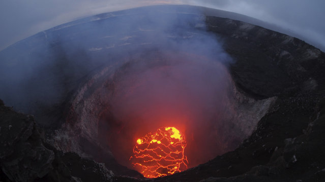This May 6, 2018 photo shows the lava lake at the summit of Kilauea near Pahoa, Hawaii. Hawaii's erupting Kilauea volcano has destroyed homes and forced the evacuations of more than a thousand people. (Photo by U.S. Geological Survey via AP Photo)