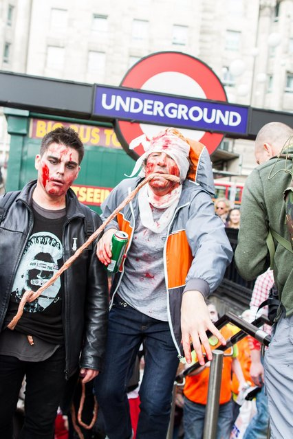 Participants pictured dressed as zombies exit a London underground station during World Zombie Day. (Photo by Michael Mba/Demotix/Corbis)