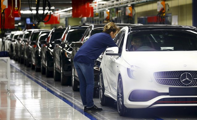 Employees of German car manufacturer Mercedes Benz make final adjustments at the end of the Mercedes A class (A-Klasse) production line at the factory in Rastatt, Germany, January 22, 2016. (Photo by Kai Pfaffenbach/Reuters)