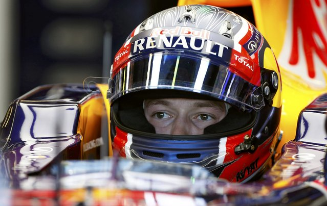 Red Bull Formula One driver Daniil Kvyat of Russia sits in his car in his garage during the first practice session of the Australian F1 Grand Prix at the Albert Park circuit in Melbourne March 13, 2015. REUTERS/Brandon Malone
