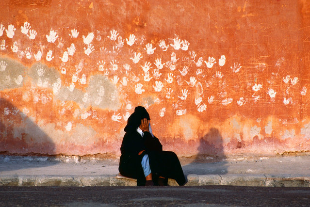 Hands on a wall in Essaouira, Morocco, 1985, by Bruno Barbey. The open hand is a symbol of good luck and protection from the evil eye. This image of palm prints was on the cover of the National Geographic centenary issue in July 1988. (Photo by Bruno Barbey/Magnum Photos)