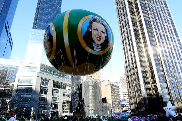 The Wizard of Oz balloon makes its way through Columbus Circle. (Photo by Tina Fineberg/Associated Press)
