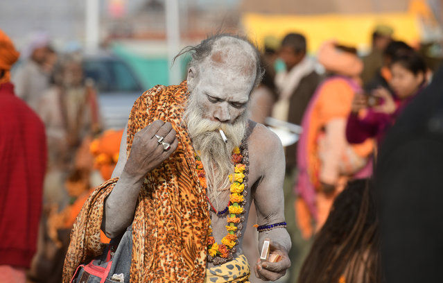 "Indian Hindu sadhus (holy men) from the Juna Akhara take part in a religious procession  towards Sangam area, during the first ""royal entry"" for the Kumbh Mela in Allahabad on December 25, 2018. (Photo by Sanjay Kanojia/AFP Photo)"