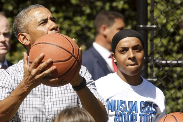 U.S. President Barack Obama plays basketball with Bilqis Abdul-Qaadir (R) as he takes a tour of the exercise activities at the annual Easter Egg Roll at the White House in Washington April 6, 2015. (Photo by Jonathan Ernst/Reuters)