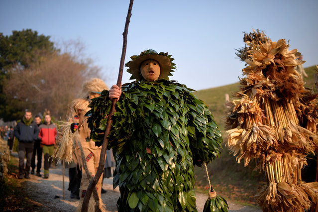 """A man dressed in a costume made out of leaves takes part in """"La Vijanera"""", a winter masquerade at the beginning of carnival season in Europe, in Silio, northern Spain, January 8, 2017. (Photo by Vincent West/Reuters)"""