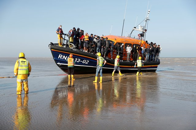 Migrants rescued from the English Channel arrive on a Royal National Lifeboat Institution (RNLI) boat at Dungeness, Britain, September 7, 2021. (Photo by Peter Nicholls/Reuters)