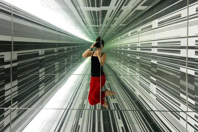 "In May, we asked Your Shot photographers to show us who they were. Over 3,300 community members submitted nearly 8,000 photos. Our editors selected 20 to publish, including this selfie of Jane Sheng seemingly suspended in an infinite hall of mirrors in Auckland, New Zealand. ""Nowadays the ubiquitous selfie can easily be overlooked as silly"", writes Monica Clare Corcoran, Your Shot managing editor. (Photo by Jane Sheng/National Geographic)"