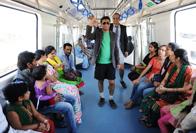 Indian commuters, stripped to their underpants, participate in a No Pants Subway Ride on the metro in Bangalore on January 12, 2014. The No Pants Subway Ride is an annual event staged across major cities of the World every January. (Photo by AFP Photo)