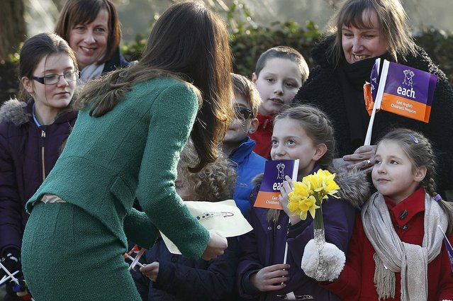 Britain's Catherine, Duchess of Cambridge, is given a picture of herself as she arrives for a visit to East Anglia's Children's Hospices (EACH) in Quidenham, Britain, January 24, 2017. (Photo by Darren Staples/Reuters)