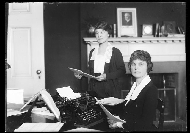 Women work in an office as a portrait of President Warren Harding is displayed on the mantle, circa 1921-1923, in this Library of Congress handout photo. (Photo by Reuters/Bain Collection/Library of Congress)