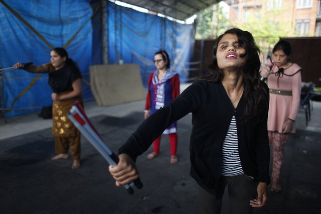 In this April 13, 2015 photo, Silpa Dhungel, a 23-year-old college student who is blind,  participates with other blind women in a self-defense course in Kathmandu, Nepal. The free self-defense course offered for blind women by Paritran, a local security agency is the first such initiative in the Himalayan nation. Women's security has become a major issue in this Himalayan nation over the past couple years, spillover from a deadly 2012 gang-rape on a New Delhi bus that was closely followed here. (Photo by Niranjan Shrestha/AP Photo)