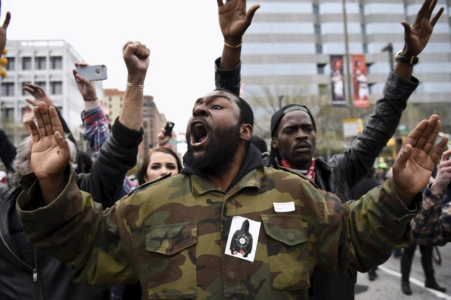 Demonstrators gesture near Camden Yards to protest against the death in police custody of Freddie Gray in Baltimore April 25, 2015. (Photo by Sait Serkan Gurbuz/Reuters)