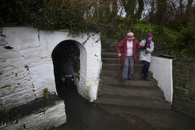 Women leave the holy well of St. Brigid on a Pattern Day pilgrimage to St. Brigid in Liscannor, Ireland February 1, 2017. (Photo by Clodagh Kilcoyne/Reuters)