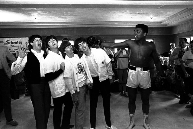 The Beatles, from left, Paul McCartney, John Lennon, Ringo Starr, and George Harrison, take a fake blow from Cassius Clay while visiting the heavyweight contender at his training camp in Miami Beach, Fla. on February 18, 1964. (Photo by AP Photo)