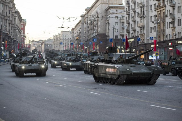 New Russian T-14 Armata tanks, foreground, make their way to Red Square during a rehearsal for the Victory Day military parade which will take place at Moscow's Red Square on May 9 to celebrate 70 years after the victory in WWII, in Moscow, Russia, Monday, May 4, 2015. (Photo by Alexander Zemlianichenko/AP Photo)